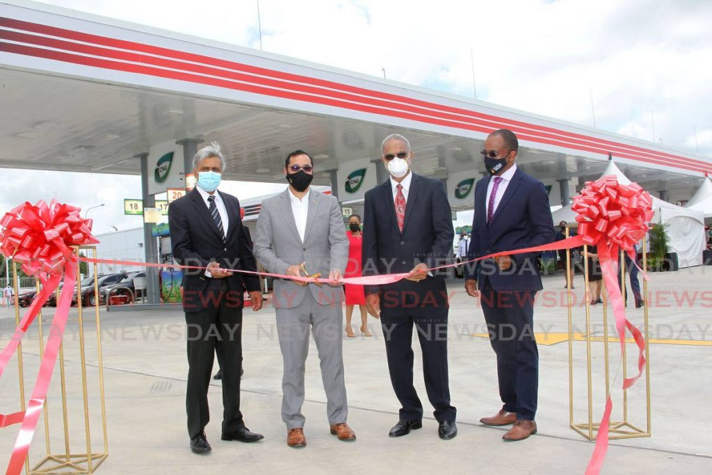 From left:  President of NGC CNG, Curtis Mohommed, Minister of Energy and Energy Industries Stuart Young, chairman of the board of NP, Sahid  Hosein and John Gormandy acting CEO of NP cut the ribbon to officially open the NP Preysal service station, Couva.  - Photo by Lincoln Holder