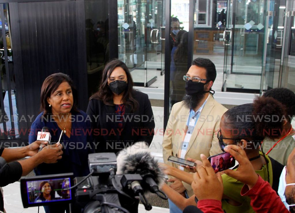 Trade and Industry Minister Paula Gopee-Scoon, left, speaks to reporters during her tour on Wednesday of the Kamri Glass Showroom in Marabella. Photo by Roger Jacob