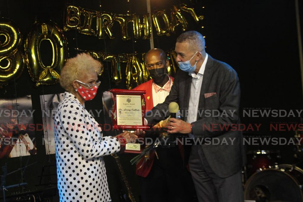 BIRTHDAY HONOUR: Patsy Calliste, wife of Leroy 'Black Stalin' Calliste collects the Legacy Award for her husband from former president Anthony Carmona and principal of Presentation College (San Fernando) Dexter Mitchell on Friday. Calliste is the first recipient of the college's Legacy Award. - Marvin Hamilton