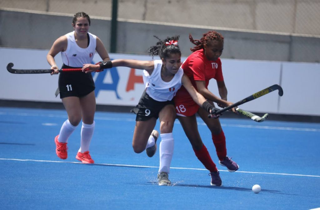 Trinidad and Tobago's Daniella Cabralis, right, in action against Peru in the Pan Am Challenge on Sunday in Lima, Peru. - Pan Am Hockey