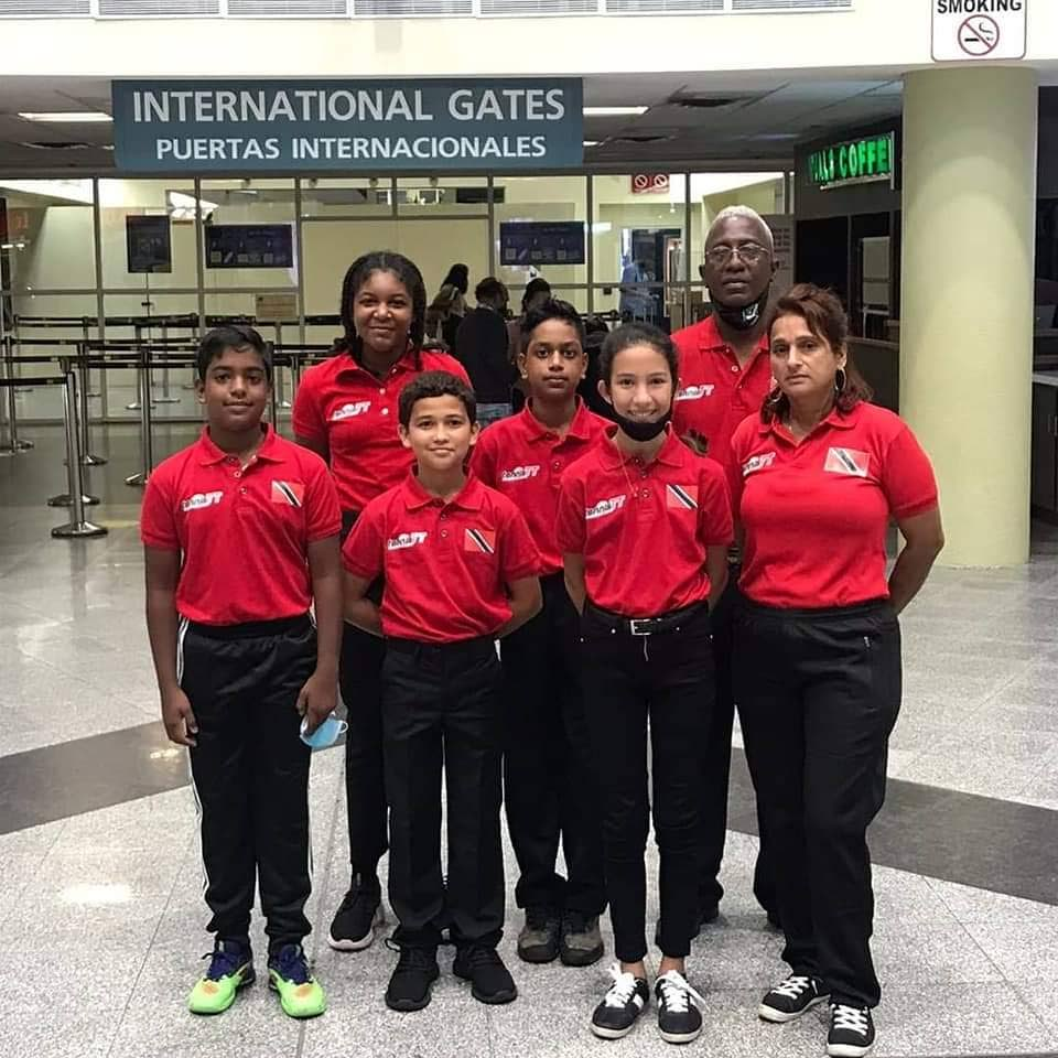 Members of the Trinidad and Tobago tennis team at the Piarco Airport before leaving for the 2021 ITF/COTECC Under-12 team competitions in the Dominican Republic. -