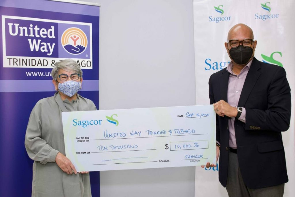 President and CEO of Sagicor General Insurance, Keston Howell, presents Dr Jennifer Sancho, CEO of United Way TT, with a cheque to support Phase 2 of their National Time of Caring Project for primary schools in high-need communities, a programme started last year.    -