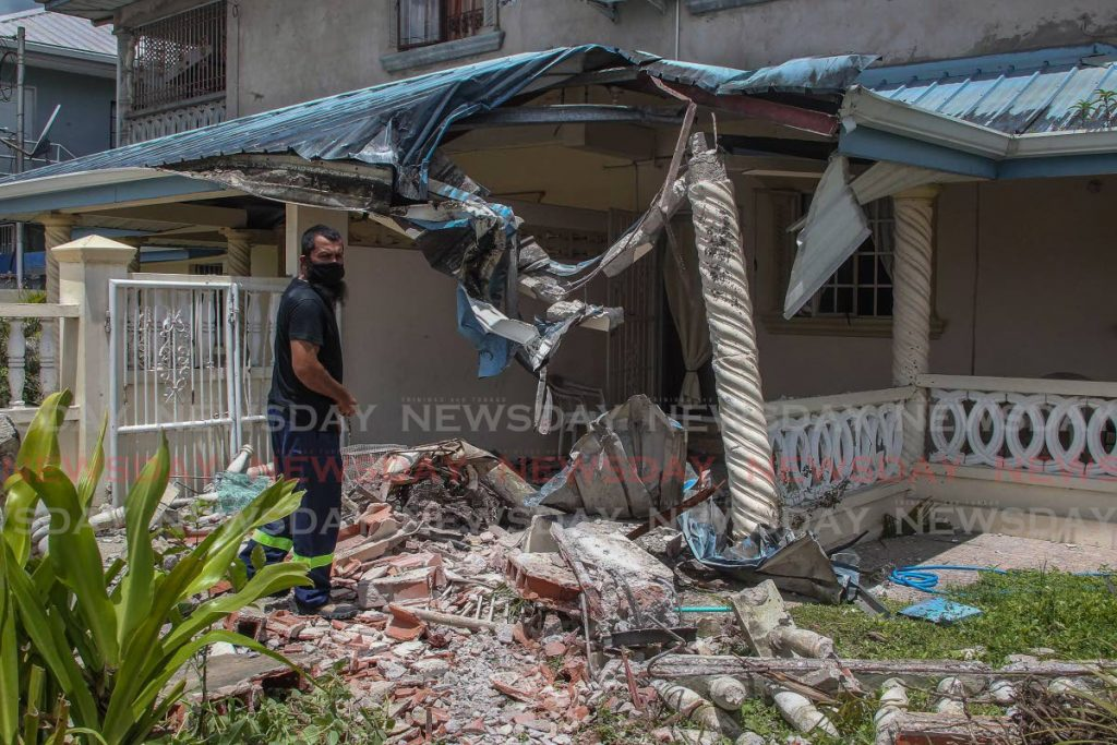 Amhad Ali walks towards the entrance of his apartment, where a PTSC bus crashed on Monday morning in Palmiste. Several passengers received minor injuries and were taken for medical treatment. - ROGER JACOB