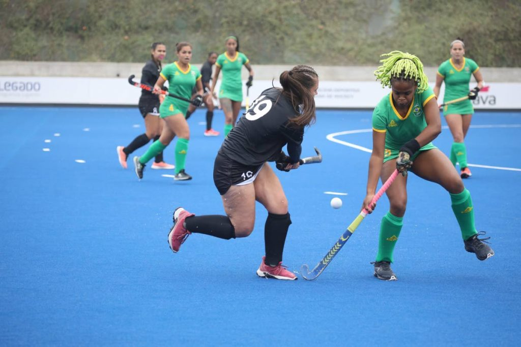 TT women's hockey team (black) take on Brazil(green), at the Pan American Hockey Challenge, on Wednesday, in Lima, Peru. The match ended 1-1. - via Pan Am Hockey