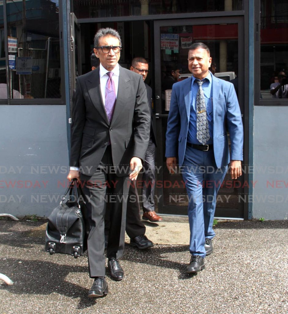 Nazim Baksh, right, owner of A&V Oil and Gas Ltd, with one of his attorneys Jagdeo Singh, left. FILE PHOTO -