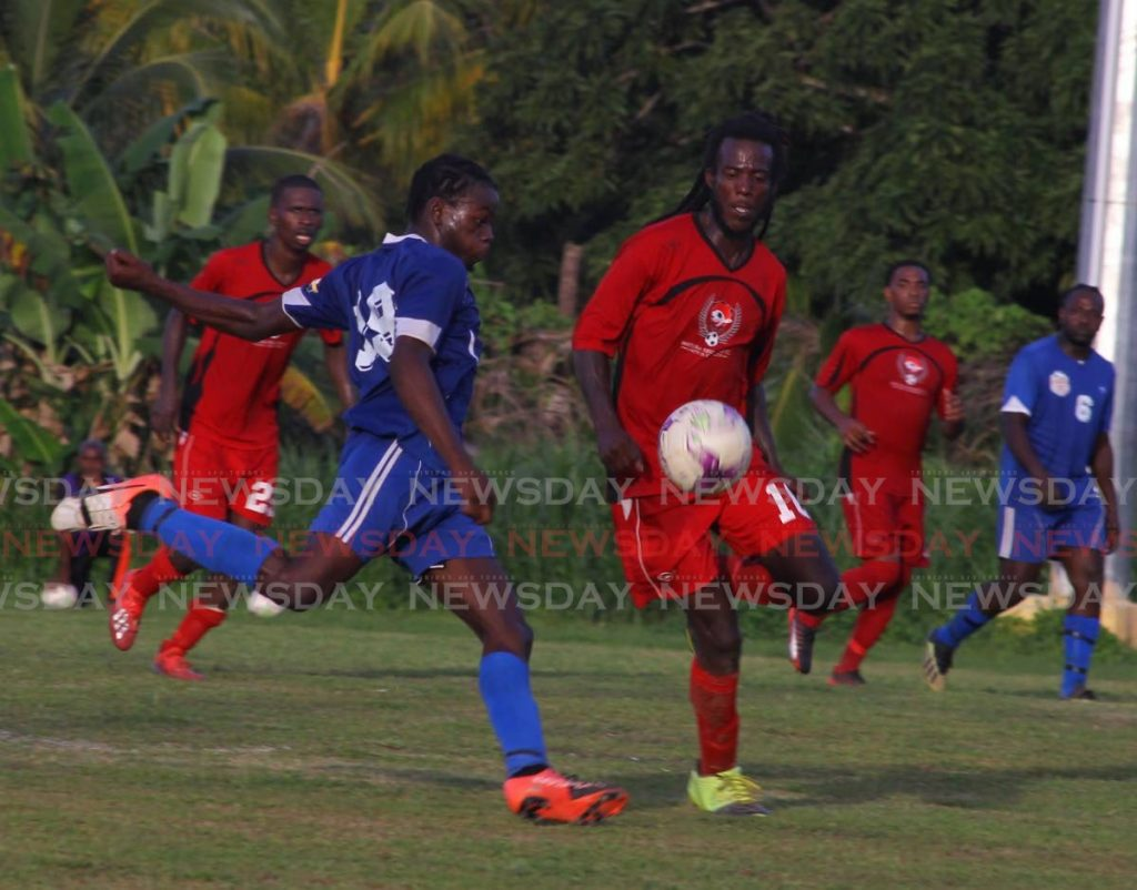 In this December 28, 2019 file photo, Bethel United (blue) take on Matura United during a TT Super League match. - Roger Jacob