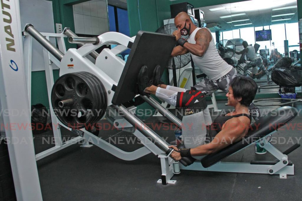 In this June 22, 2020 file photo, Women's phisique athlete Marisa Lutchman trains with personal trainer Wazim Mohammed at Gulf View Health and Fitness Gym at La Romain. -