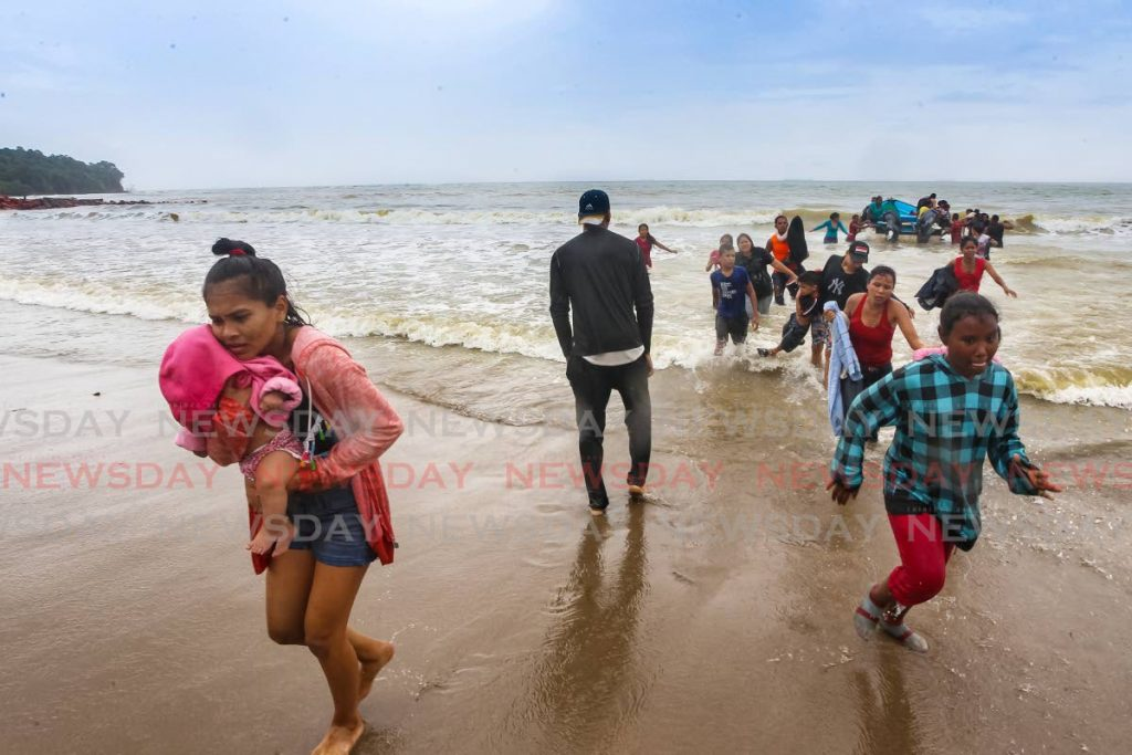 In this November 24, 2020 file photo Venezuelans arrive on a beach in Los Iros. Naparima MP Rodney Charles said migrants continue to arrive in the country illegally during the 2022 budget debate on Saturday. Photo by Lincoln Holder -