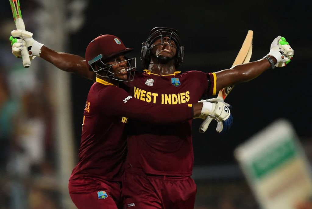 FLASHBACK: In this April 3, 2016 file photo, West Indies's Carlos Brathwaite(R)and teammate Marlon Samuels celebrate after victory in the World T20 final against England, at The Eden Gardens Cricket Stadium in Kolkata, India. On October 23, the Windies begin their defence of the title, at the T20 World Cup in the UAE.  -