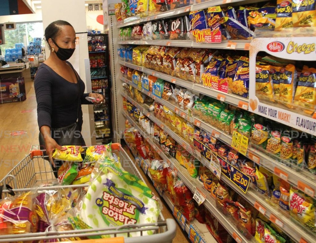 In this file photo, Liza De Verteuil does her grocery shopping at Massy Stores, Mandalay, Arima. - Photo by Angelo Marcelle