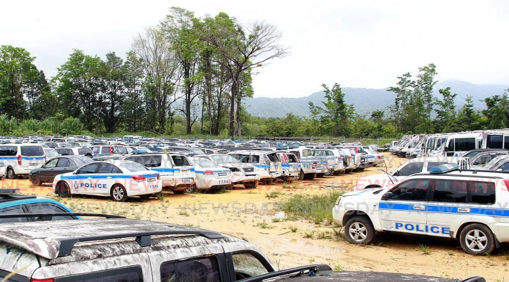 The police vehicle impound lot in Cumuto: the last stop for unserviceable police vehicles that have been damaged or fallen into disrepair.  - FILE PHOTO/ROGER JACOB