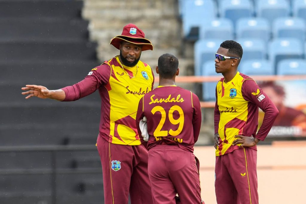 West Indies T20 captain Kieron Pollard (left) speaks to his vice-captain Nicholas Pooran (centre) and Akeal Hosein during a series  against South Africa earlier this year.  -