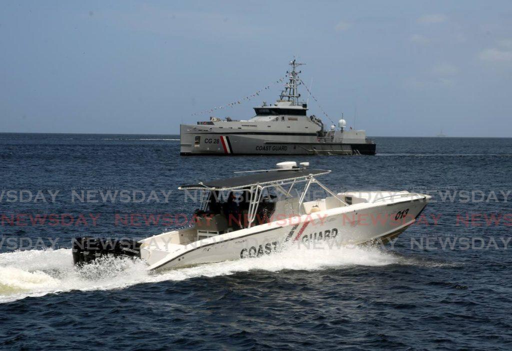 A coast guard interceptor vessel and larger patrol boat. Photo by Sureash Cholai