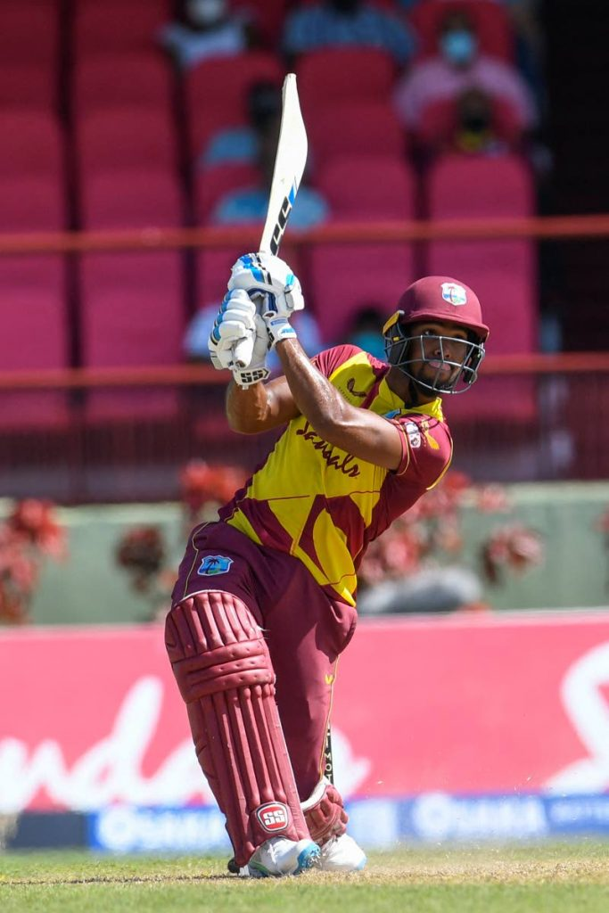 In this file photo,  West Indies vice-captain Nicholas Pooran smashes a six during the 2nd T20 International against Pakistan at the Guyana National Stadium in  Providence, Guyana, on July 31, 2021.  - via Randy Brooks
