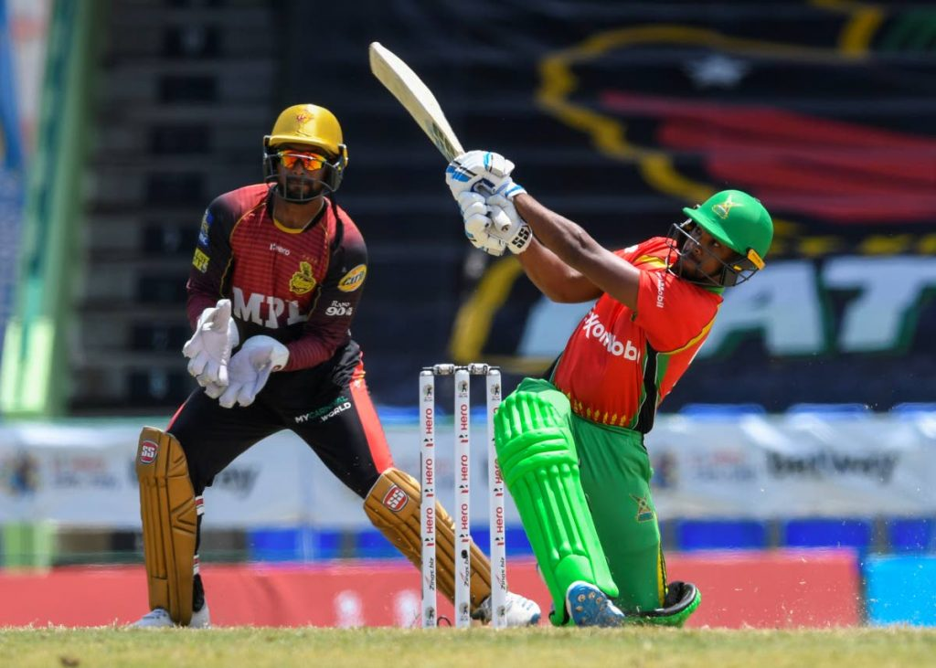 In this Sep 1 file photo, Nicholas Pooran (R) of Guyana Amazon Warriors hits 6 as Denesh Ramdin (L) of Trinbago Knight Riders looks on during the 2021 Hero Caribbean Premier League match 11 at Warner Park Sporting Complex, St Kitts. - Photo courtesy CPL T20