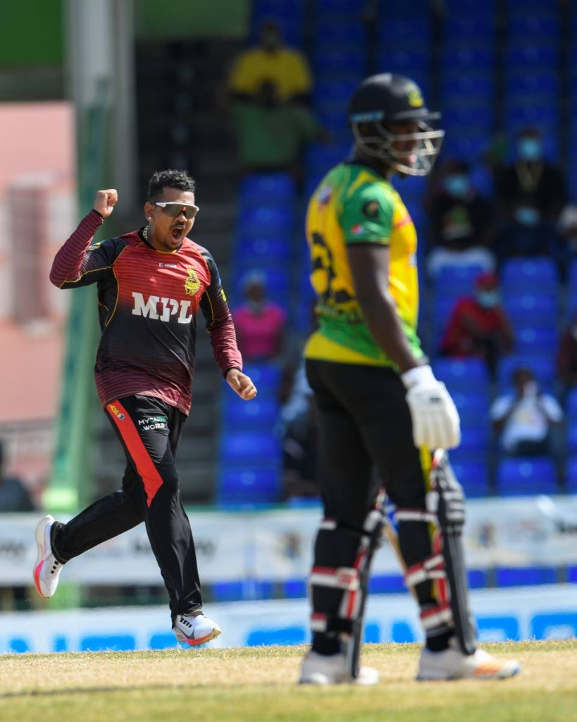 In this September 9 file photo,  Sunil Narine (L) of Trinbago Knight Riders celebrates the dismissal of Rovman Powell (R) of Jamaica Tallawahs during the 2021 Hero Caribbean Premier League match 18 at Warner Park Sporting Complex, in Basseterre, St Kitts. Narine was left out of the West Indies T20 squad that will be defending their ICC T20 World Cup title from October 18. - Photo courtesy CPL T20