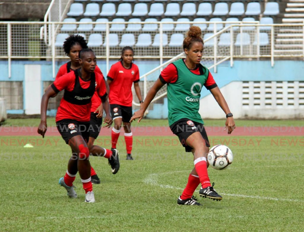 In this Sep 15, 2021 file photo, former Trinidad and Tobago captain Maylee Attin-Johnson, right, kicks the ball during a team training session, at the Ato Boldon Stadium, Couva. On Monday, the TT Football Association said the team will host two friendlies on Oct 21 and 25 against Panama. - AYANNA KINSALE