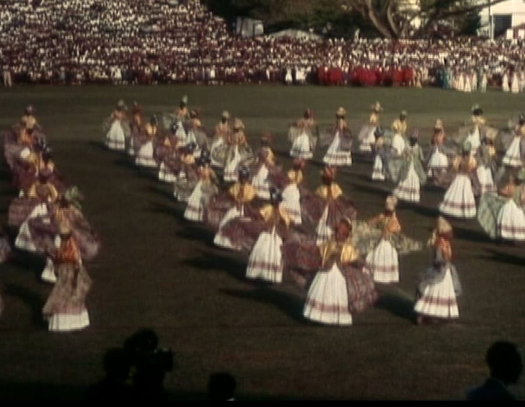 A scene from Rhythms of Trinidad by Andreas Antonopoulos where performers dance the bele. -