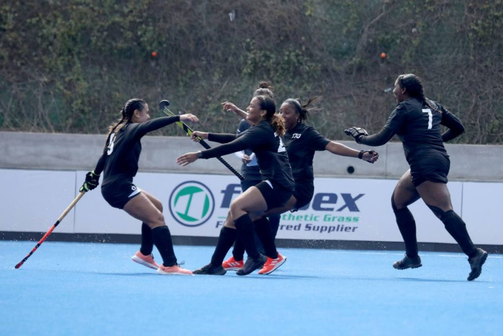 Members of the TT women hockey team celebrate a goal during their Pan Am Challenge semi-final match against Paraguay in Lima, Peru on Friday. PHOTO COURTESY PAN AM HOCKEY. -