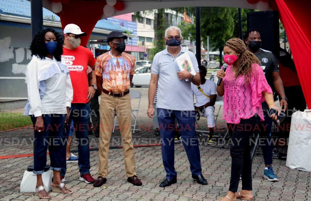 Education Minister Dr Nyan Gadsby-Dolly, right, speaks during the Health Ministry's vaccination drive on Brian Lara Promenade, Port of Spain, on Saturday. Alongside her are, from left, Social Development Minister Donna Cox, Communication Minister Symon de Nobriga, calypsonian Timothy
