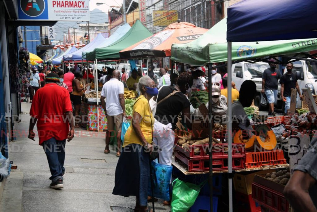 Vendors and shoppers in brisk trade on Charlotte Street, Port of Spain on Saturday. Cabinet will decide on safe zones soon, Attorney General Faris Al-Rawi said on Saturday. - Photo by Sureash Cholai