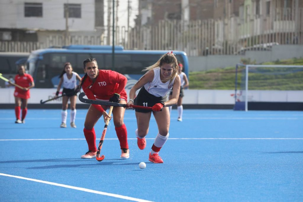In this photo taken on Oct 2, Trinidad and Tobago's Brianna Govia (second from right) and Peru's captain Camila Mendez chase after the ball during their teams' final of the Pan Am Challenge at Lima, Peru.  -