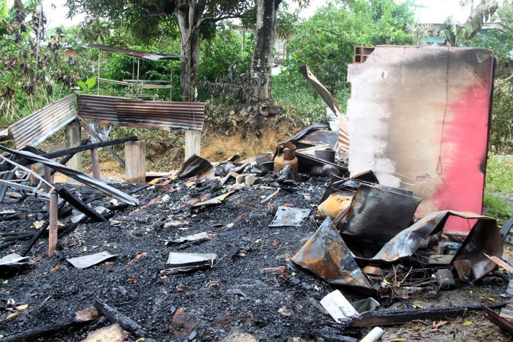 ALL GONE: The remains of a house in Fyzabad which was gutted by fire and in which a woman and her son perished on Saturday. PHOTO BY ROGER JACOB -