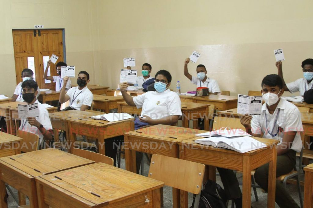 FILE PHOTO: Vaccinated students of Presentation College San Fernando displays their Immunisation cards in their classroom last Monday. - Marvin Hamilton