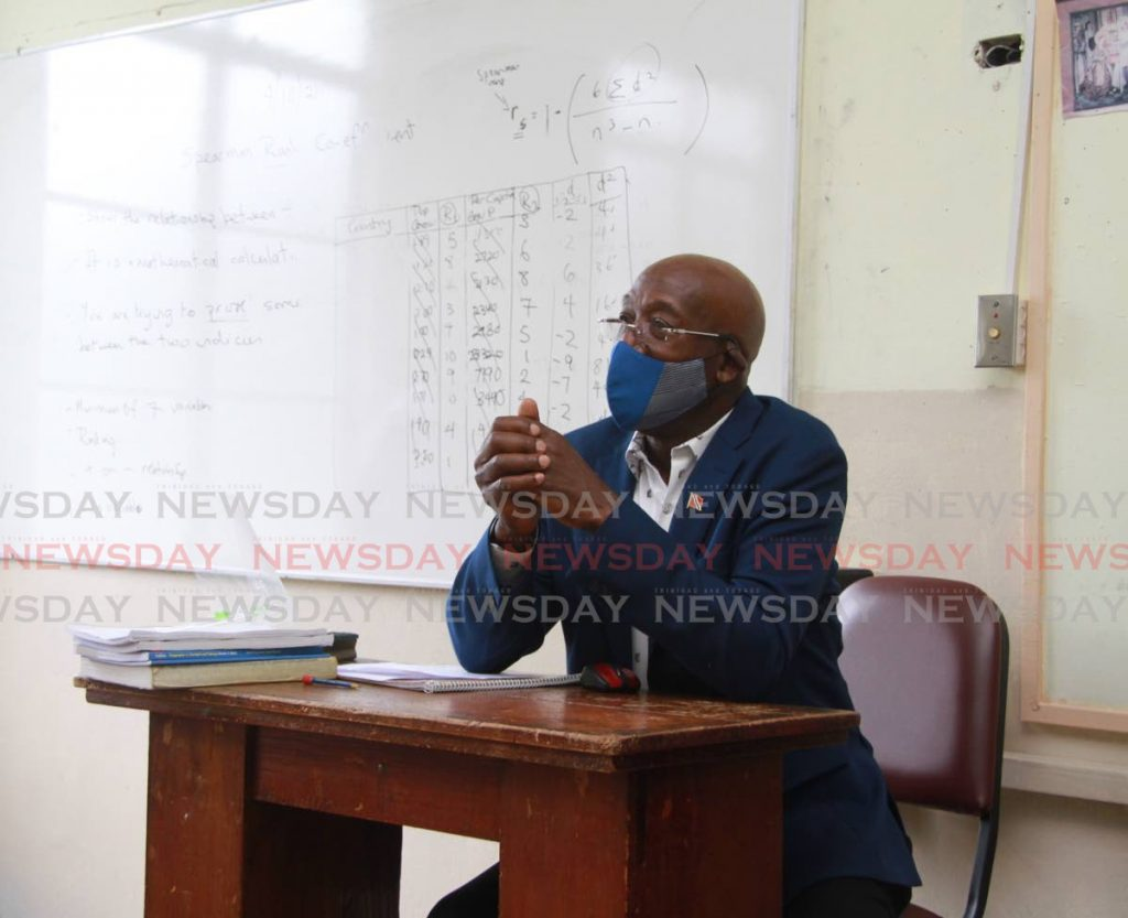 BACK TO SCHOO: Prime Minister Dr Keith Rowley sits in a classroom at St Joseph's Convent in Port of Spain which he visited on Monday. PHOTO COURTESY OFFICE OFF THE PRIME MINISTER -