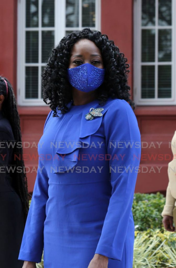 Social Development and Family Services Minister Donna Cox outside the Red House before the presentation of the 2022 budget in Parliament on Monday. - Photo by Sureash Cholai
