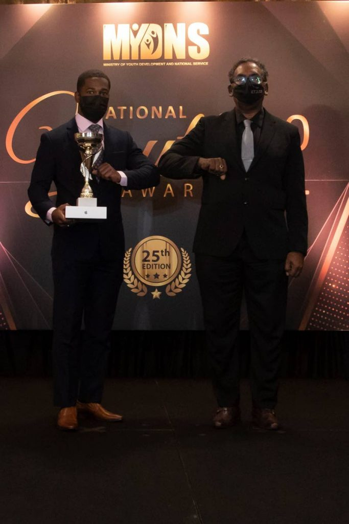 Olympic cyclist Kwesi Browne, left, with his National Youth Award for Community Sport (18-35).  - Ministry of Youth Development and National Service