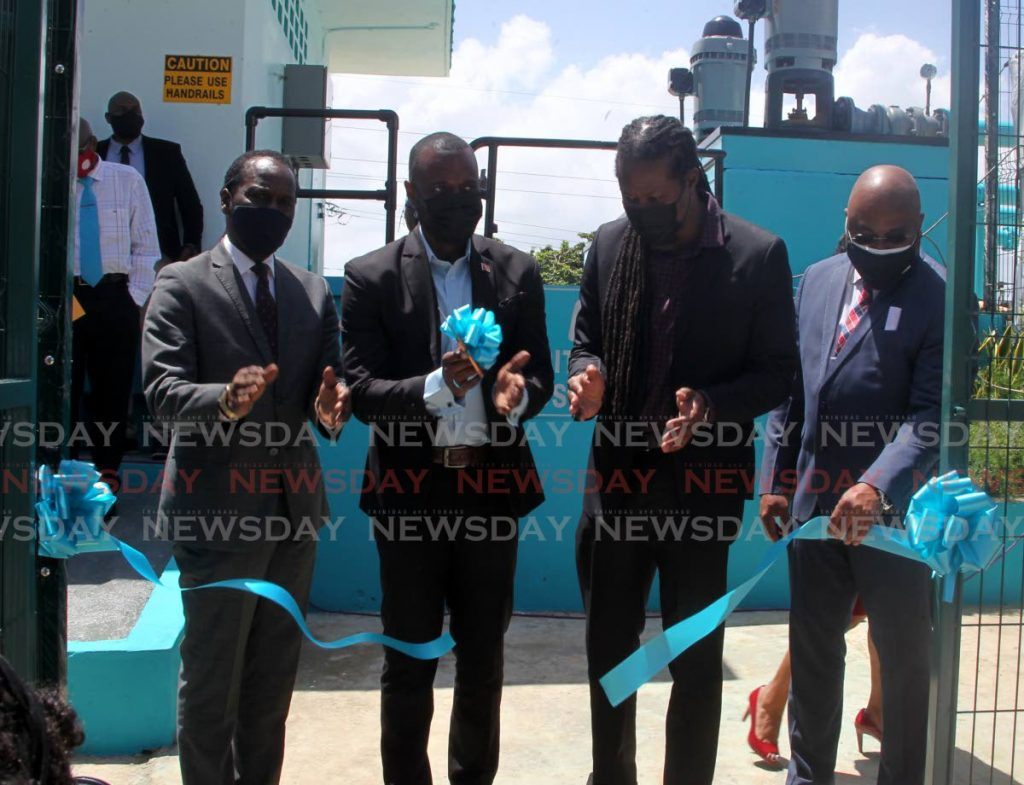 BLUE RIBBON EVENT: Public Utilities Minister Marvin Gonzales, 2nd from left, cuts the ribbon on Wednesday to formally open the refurbished WASA booster station in Pitch Road, Morvant. Also in photo from left are Laventille West MP Fitzgerald Hinds, Laventille East/Morvant MP Adrian Leonce and WASA CEO Sherland Sheppard. PHOTO BY ROGER JACOB -