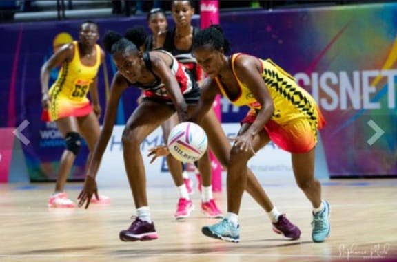 TT's Jameela McCarthy, left, tussles for the ball during a recent netball match.  -