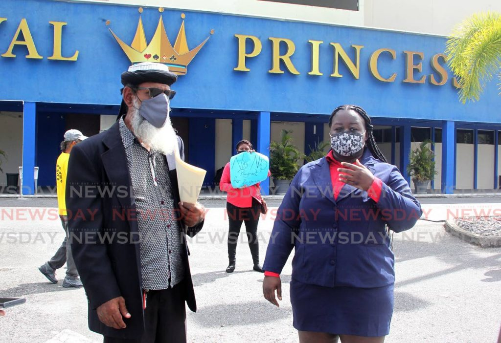 Head of the First Wave Movement Umar Abdullah and supervisor at Royal Princess Casino Adanna Morgan speak to the media as the casino's employees protest at South Park Shopping Complex, Toruba, San Fernando.  - ROGER JACOB