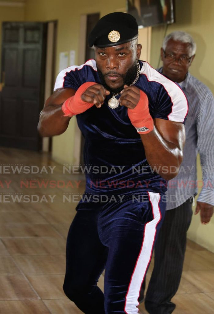 """Soca artiste Marvin """"Swappi"""" Davis shows off his boxing moves while training the Sea Lots Community Centre in Port of Spain on Friday.  - SUREASH CHOLAI"""