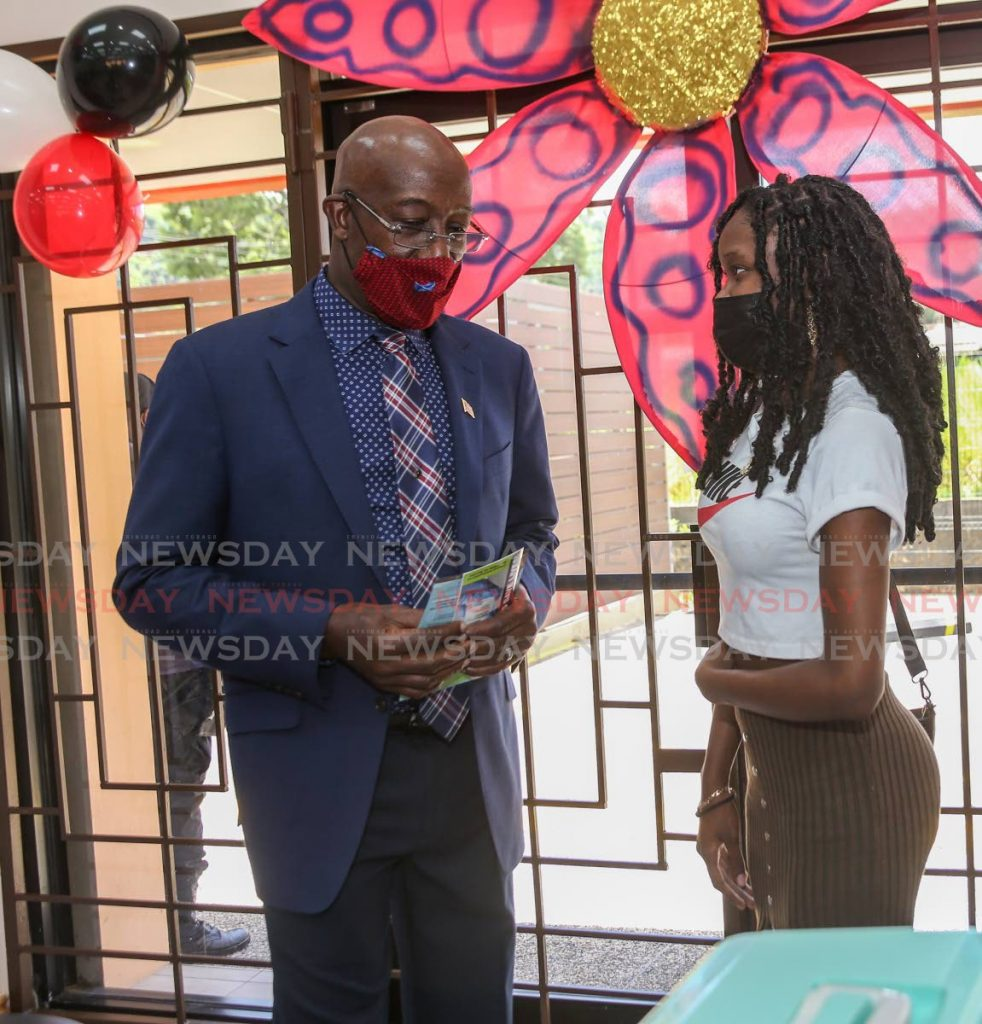 Shania Baptiste chats with Prime Minister Dr Keith Rowley after she got the one-dose Johnson and Johnson vaccine at Diego Martin South Community Centre, Diego Martin. - Photo by Jeff Mayers
