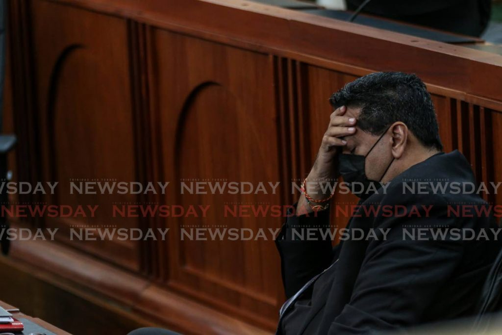 MP Rushton Paray catching up on some sleep during the debate on the 2021/2022 budget in Parliament on Saturday. - Jeff Mayers