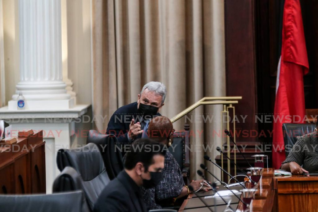 Minister of Finance Colm Imbert talks with  Minister of Planning and Development Camille Robinson-Regis during the debate on the 2021/2022 budget in Parliament on Saturday. - Jeff Mayers