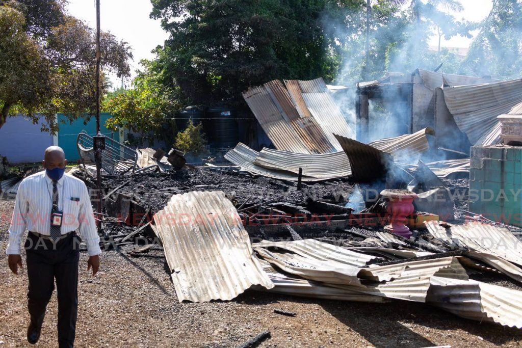 Fire officers were at the scene on Monday to investigate the cause of a Sunday night blaze which destroyed a house and car at Store Bay Branch Road, Bon Accord . - David Reid