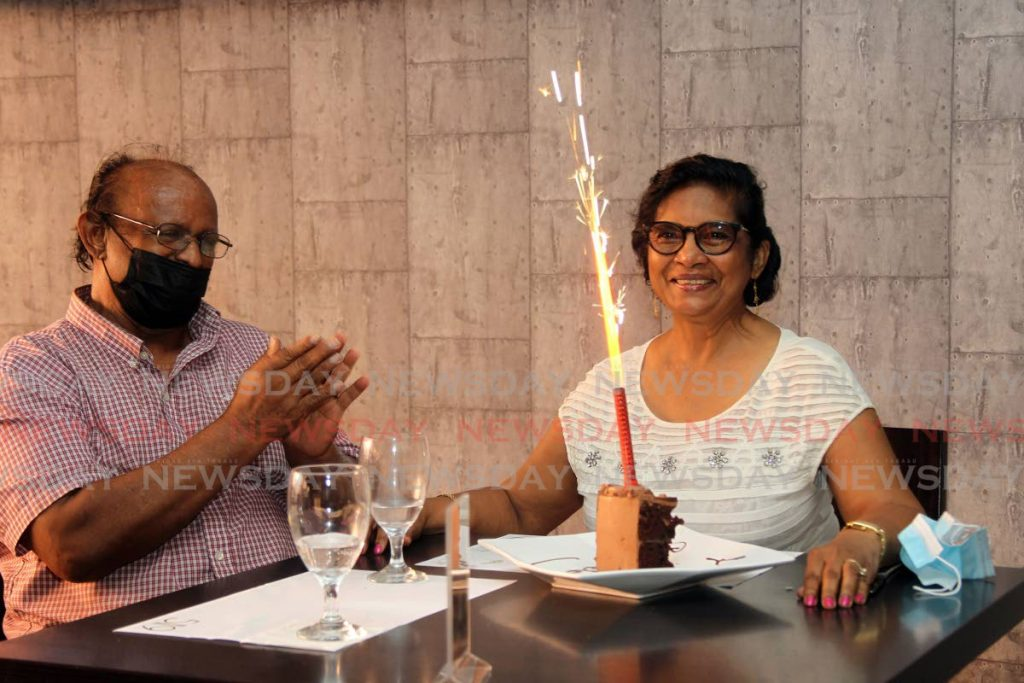 Radha Ramjattan and her husband Winston celebrate her birthday at 519 Restaurant at C3 Mall, San Fernando as safe zones opened around the country on Monday. - Lincoln Holder
