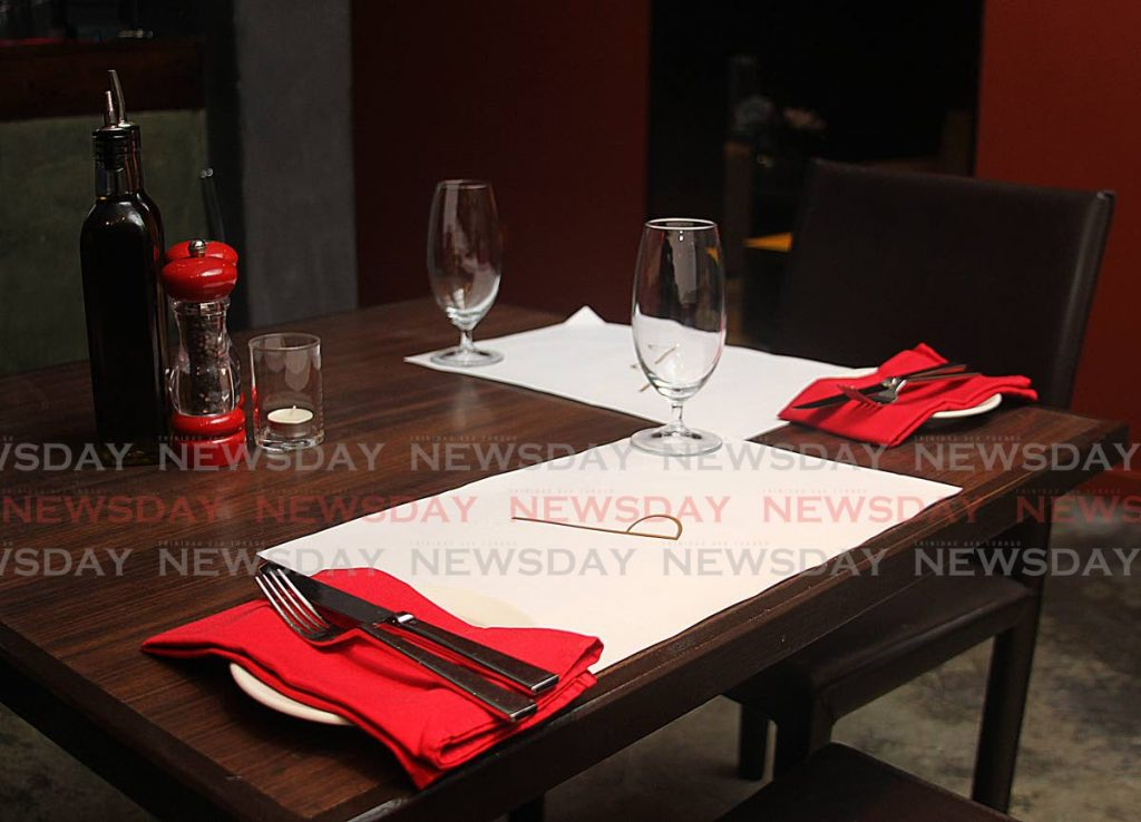 A table setting for two at a restaurant which reopened on Monday as a safe zone. - ROGER JACOB