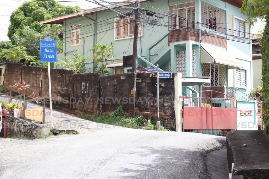 NO ONE OUTSIDE: Bath Street in East Port of Spain is deserted on Wednesday morning hours after one of its residents, garbage collector Nizam Ali Cadette, was gunned down on Laventille Road while doing his job. PHOTO BY ROGER JACOB  -