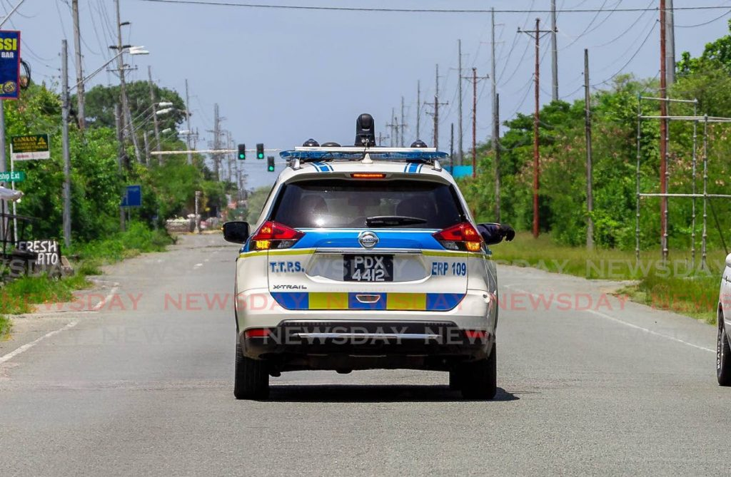 FILE PHOTO: Police on patrol along the Claude Noel Highway, Shirvan. -