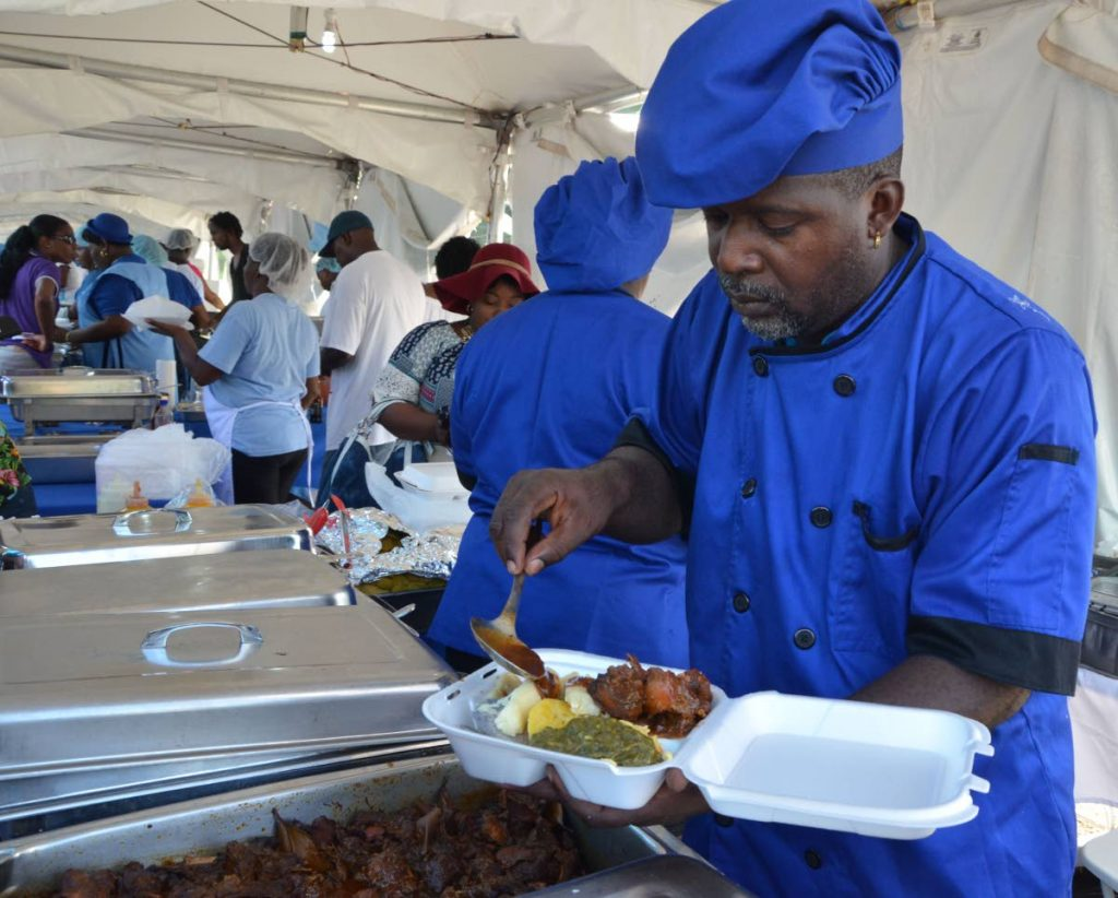 Blue Food chef Kevin Charles takes out a meal for a customer during the 2018 Blue Food Festival. -