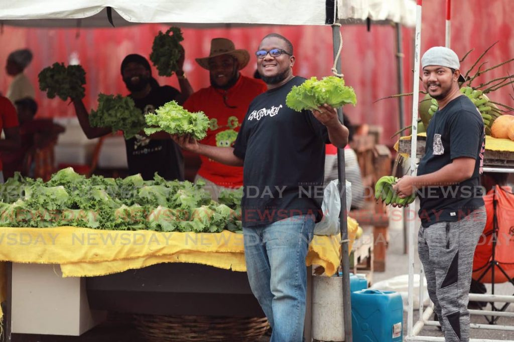 GREEN HANDS: Agripreneur and founder of NGO WhyFarm Alpha Sennon, centre, who spoke at the NOW Nestlé Caribbean Youth Summit held on October 5-6. FILE PHOTO -